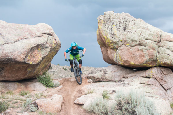Solo Rider at Hartman Rocks with dark clouds in the background