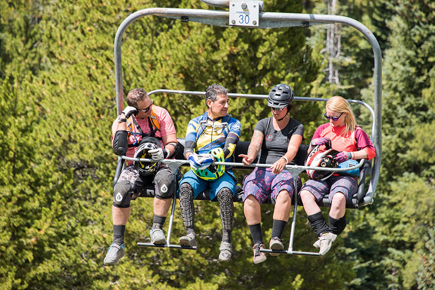 Outerbike participants riding the chairlift up to test bikes