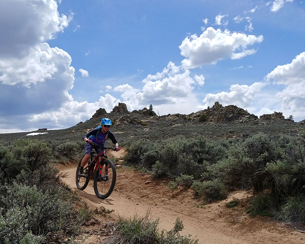 female mountain biker on Becks Trail at Hartman Rocks in Gunnison