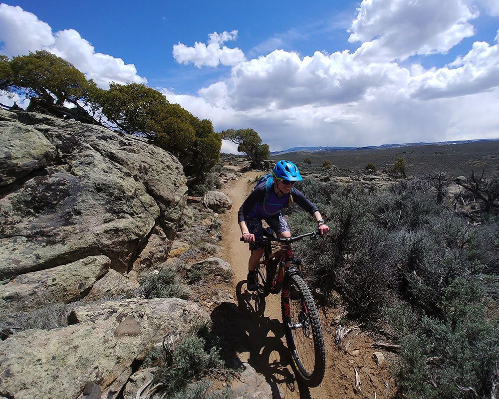 solo mountain biker on Rocky Ridge trail descent at Hartman Rocks