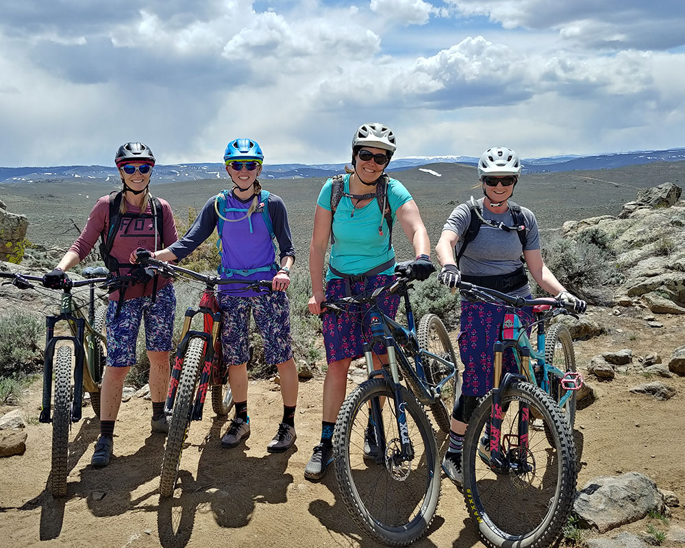 four female mountain bikers posing in matching shorts near Gunnison, CO